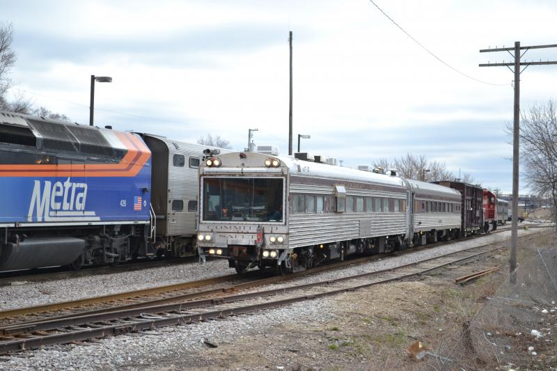 The CP Geometry train (left) sits next to Metra locomotive 426 as it waits to begin its trip south from Fox Lake. (Photo by Edward A. Oom/CP)